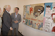 Evelyn de rothschild and Tim Jeffries. Basquiat private view. Hamiltons. London. 19 June 2002. © Copyright Photograph by Dafydd Jones 66 Stockwell Park Rd. London SW9 0DA Tel 020 7733 0108 www.dafjones.com