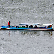 A fast passenger boat travels up the Nam Ou (River Ou) in Nong Khiaw in northern Laos.