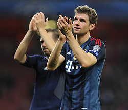 Bayern Munich's Thomas Muller celebrates on the final whistle with the Bayern fans - Photo mandatory by-line: Joe Meredith/JMP - Tel: Mobile: 07966 386802 19/02/2014 - SPORT - FOOTBALL - London - Emirates Stadium - Arsenal v Bayern Munich - Champions League - Last 16 - First Leg