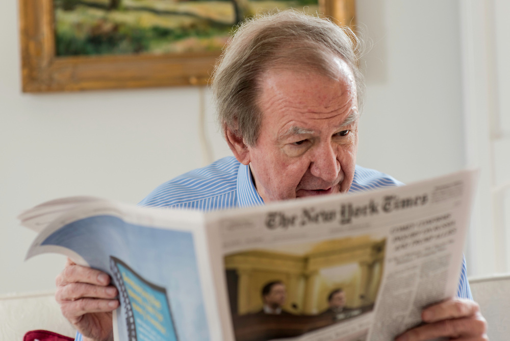 MCLEAN, VA -- 3/21/17 -- Buchanan reads five newspapers front-to-back everyday. Respected conservative commentator Pat Buchanan reflects on his career at his home in McLean. .…by André Chung #_AC12700