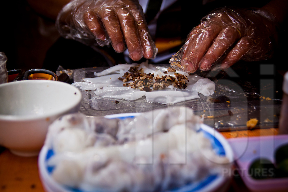 A woman makes banh cuon in Hanoi's old quarter, Vietnam, Asia
