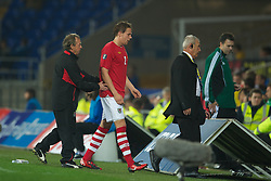 CARDIFF, WALES - Friday, October 8, 2010: Wales' new manager Brian Flynn consoles Chris Gunter as he walks off dejected after being sent off against Bulgaria during the UEFA Euro 2012 Qualifying Group G match at the Cardiff City Stadium. (Pic by David Rawcliffe/Propaganda)