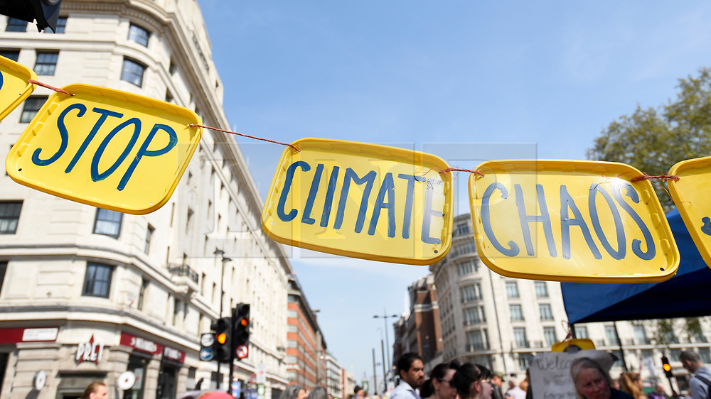 """© Licensed to London News Pictures. 22/04/2019. LONDON, UK.  Signs made by activists gathered at Marble Arch during """"London: International Rebellion"""", on day eight of a protest organised by Extinction Rebellion.  Protesters are demanding that governments take action against climate change.  After police issued section 14 orders at the other protest sites of Oxford Circus, Waterloo Bridge and Parliament Square resulting in over 900 arrests, protesters have convened at the designated site of Marble Arch so that the protest can continue.  Photo credit: Stephen Chung/LNP"""