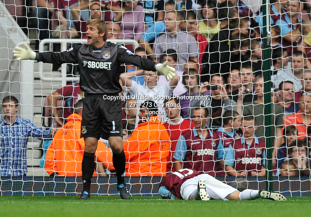 21/08/2010 - Premiership Football - West Ham United vs Bolton Wanderers - Matthew upson lies injured after being kicked in the head. - Photo: Charlie Crowhurst / Offside.