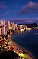 Waikiki Beach at twilight, with Diamond Head Crater on right, Honolulu, Oahu, Hawaii USA.