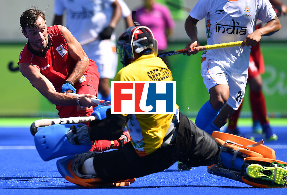 Belgium's Sebastien Dockier (L) vies with India's Sreejesh Parattu during the men's quarterfinal field hockey Belgium vs India match of the Rio 2016 Olympics Games at the Olympic Hockey Centre in Rio de Janeiro on August 14, 2016. / AFP / MANAN VATSYAYANA        (Photo credit should read MANAN VATSYAYANA/AFP/Getty Images)