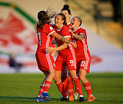 NEWPORT, WALES - Tuesday, June 12, 2018: Wales' Natasha Harding (left) celebrates scoring the third goal with team-mates Kayleigh Green and Jessica Fishlock during the FIFA Women's World Cup 2019 Qualifying Round Group 1 match between Wales and Russia at Newport Stadium. (Pic by David Rawcliffe/Propaganda)