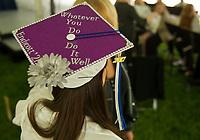 Individually decorated mortar boards adorned graduating seniors at the Inter-Lakes High School graduation Saturday morning in Prescott Park.  (Karen Bobotas/for the Laconia Daily Sun)