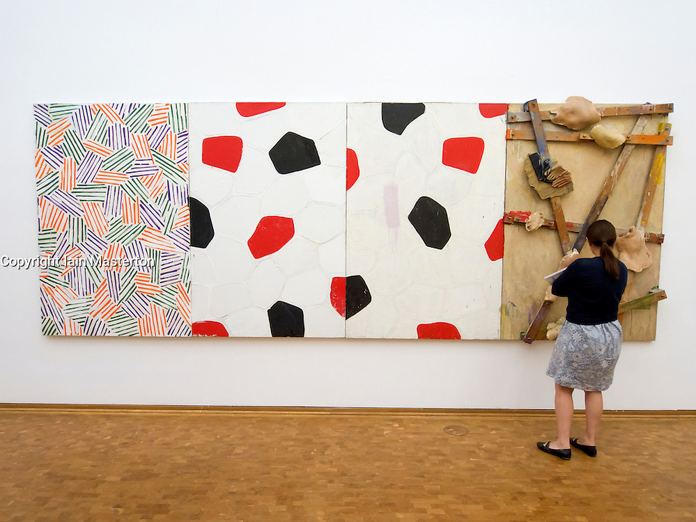 Woman looking at Untitled painting by Jasper Johns on display at Museum Ludwig in Cologne Germany