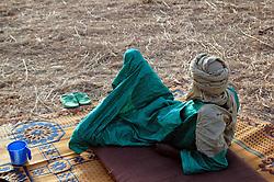 Niger, Agadez, Tidene, 2007. Heishi Ali enjoys the morning cool around 6 AM at Rissa Ixa's camp. March temperatures regularly break 40 centigrade.