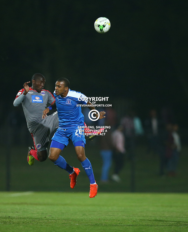 Deolan Mekoa of Maritzburg Utd out jumps Aubrey Modiba of SuperSport United during the 2016 Premier Soccer League match between Maritzburg Utd and SuperSport United held at the Harry Gwala Stadium in Pietermaritzburg, South Africa on the 21st September 2016<br /> <br /> Photo by:   Steve Haag / Real Time Images