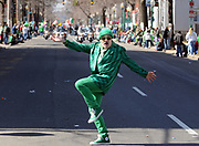 Richard Bengivengo of New Haven cuts up before watching the St. Patrick's Day Parade, New Haven. Photo by Mara Lavitt/New Haven Register<br /> <br /> 3/11/12