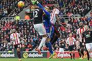 Sunderland's Goalkeeper Vito Mannone punches clear under pressure from Manchester United's Defender Chris Smalling during the Barclays Premier League match between Sunderland and Manchester United at the Stadium Of Light, Sunderland, England on 13 February 2016. Photo by George Ledger.