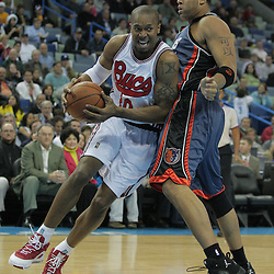 10 December 2008:  New Orleans Hornets forward David West (30) drives against Charlotte Bobcats forward Sean May (42) during a NBA regular season game between the Charlotte Bobcats and the New Orleans Hornets at the New Orleans Arena in New Orleans, LA. The game was an NBA Hardwood Classic with the Hornets dressed out in throwback uniforms honoring the former ABA franchise the New Orleans Buccaneers..