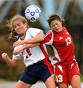 CA[TION CORRECTION NEW HYDE PARK, NY - NOVEMBER 14, 2009: Cold Sring Harbor's Elizabeth Ludlow (12) and Center Moriches' Alexis Parlato (13) go head to head during Center Moriches 1-0 win over Cold Spring Harbor in the Long Island High School Girls Soccer Finals at Tully Field. Parlato scored the winning goal. Photo by Kathy Kmonicek