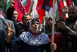 April 15, 2018 - Gaza City, The Gaza Strip, Palestine - Palestinian protesters chant slogans and wave the flags of Palestine, Syria and Iran during a demonstration against strikes carried out by the United States, Britain and France against Syria's regime, in Gaza City on April 14, 2018. (Credit Image: © Mahmoud Issa/Quds Net News via ZUMA Wire)