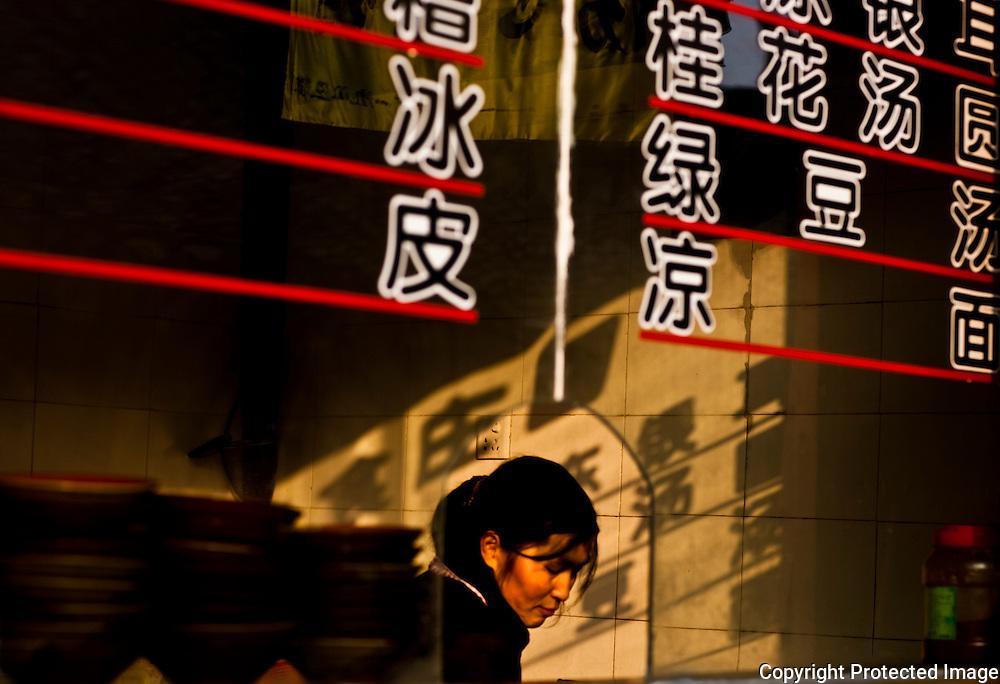 Noodle vendor in her shop, Lang Zhong, Sichuan