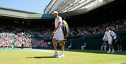 LONDON, ENGLAND - Wednesday, July 1, 2009: Ivo Karlovic (CRO) and Roger Federer (SUI) walk onto court before the Gentlemen's Singles Quarterfinal on day nine of the Wimbledon Lawn Tennis Championships at the All England Lawn Tennis and Croquet Club. (Pic by David Rawcliffe/Propaganda)
