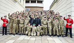"Hollywood actors Gerard Butler and Aaron Eckhart join soldiers from F Company the Scots Guards in a 'Sparta salute'.  Butler met the soldiers at Wellington Barracks in Central London ahead of a special preview screening of Hollywood movie Olympus Has Fallen, released 17th April 2013. ..The actors spent time talking to the soldiers prior to the troops watching a special preview of the film in the barracks.  Commenting on meeting the men and women from the various Guards regiments Aaron Eckhart stated:..""Wow, what an honour! They're a great bunch of guys!""...NOTE TO DESKS: .MoD release authorised handout images. .All images remain crown copyright. .Photo credit to read - Sergeant Alison Baskerville RLC"
