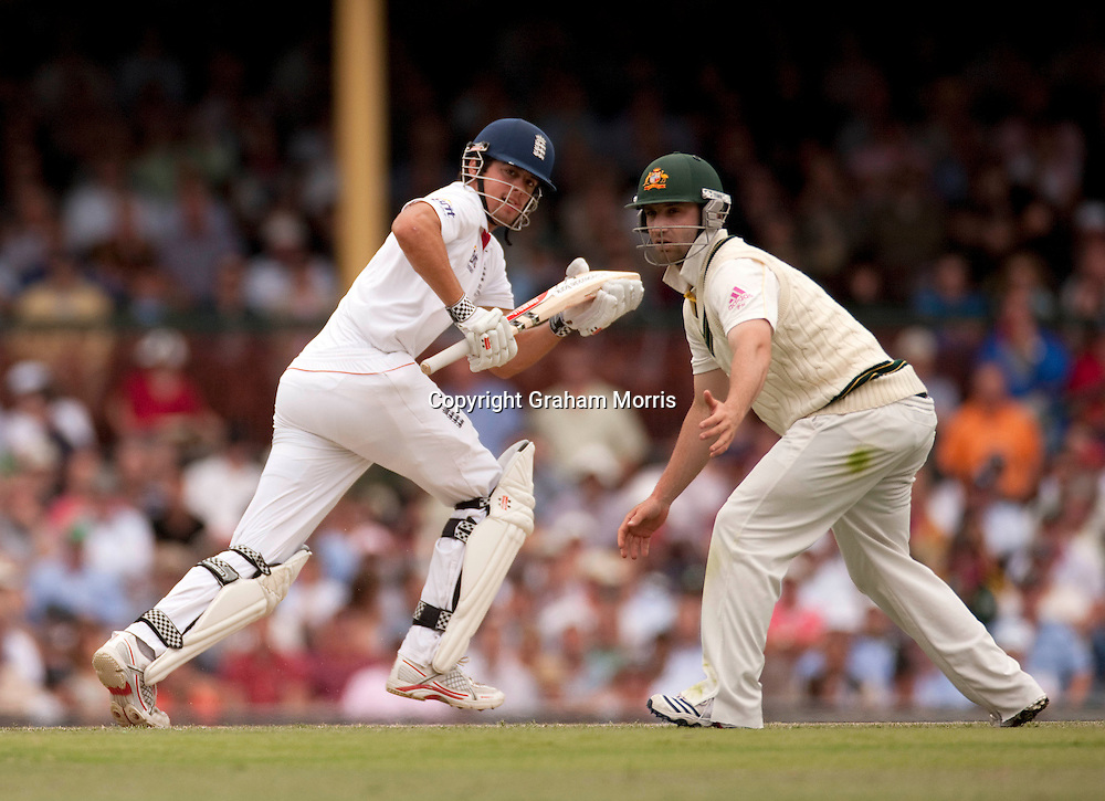 Alastair Cook bats (past Phillip Hughes) during the fifth and final Ashes test match between Australia and England at the SCG in Sydney, Australia. Photo: Graham Morris (Tel: +44(0)20 8969 4192 Email: sales@cricketpix.com) 04/01/11