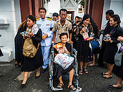 29 OCTOBER 2016 - BANGKOK, THAILAND: Thais leave the Grand Palace after they paid homage to the late Bhumibol Adulyadej, the King of Thailand. Saturday was the first day Thais could pay homage to the funeral urn of the late Bhumibol Adulyadej, King of Thailand, at Dusit Maha Prasart Throne Hall in the Grand Palace. The Palace said 10,000 people per day would be issued free tickerts to enter the Throne Hall but by late Saturday morning more than 100,000 people were in line and the palace scrapped plans to require mourners to get the free tickets. Traditionally, Thai Kings lay in state in their urns, but King Bhumibol Adulyadej is breaking with tradition. His urn reportedly contains some of his hair, but the King is in a coffin,  not in the urn. The laying in state will continue until at least January 2017 but may be extended.       PHOTO BY JACK KURTZ