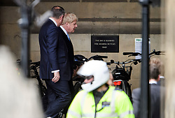 © Licensed to London News Pictures. 20/06/2019. London, UK. BORIS JOHNSON MP is talking to CONOR BURNS MP at the Houses of Parliament the morning after surviving the latest round of voting in the conservative leadership race. . Further candidates are expected to drop out of the race to be the next Prime Minister over the next two days, leaving two, in a series of votes held by Conservative MPs at Parliament. Photo credit: Ben Cawthra/LNP