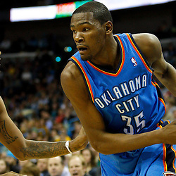 January 24,  2011; New Orleans, LA, USA; Oklahoma City Thunder small forward Kevin Durant (35) is guarded by New Orleans Hornets small forward Trevor Ariza (1) during the fourth quarter at the New Orleans Arena. The Hornets defeated the Thunder 91-89. Mandatory Credit: Derick E. Hingle