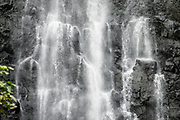The impressive Hanakapiai Falls (300 feet high) is a slippery side trip from Kalalau Trail, on Na Pali Coast, Kauai, Hawaii, USA. A beautiful day hike along the Kalalau Trail goes from Ke'e Beach to Hanakapiai Beach, with a rougher side trip to impressive Hanakapiai Falls, in Na Pali Coast State Wilderness Park on the island of Kauai. To reach Hanakapiai Valley's waterfall, follow the signed clay trails for a moderately strenuous 8.8 miles round trip with 2200 feet cumulative gain (measured on my GPS), and bring plenty of fresh water. I recommend boots with sturdy tread, hiking poles, plus water shoes for the several stream crossings. Arrive early to get parking at the trailhead in Haena State Park at the end of the Kuhio Highway (Hawaii Route 560). The gorgeous Kalalau Trail was built in the late 1800s to connect Hawaiians living in the remote valleys. No permit is needed for day hiking to Hanakapiai Falls. But hikers going onwards from Hanakapiai Beach to Hanakoa and Kalalau Valleys require a camping permit from the Hawaii Department of Land and Natural Resources (HDLNR).