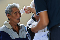 A cataract surgery patient having his dressings removed, Bali, Indonesia.