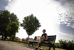 © Licensed to London News Pictures . 26/07/2018. Manchester , UK . A man basks on a bench in Chimney Pot Park in Salford . People enjoy the summer sunshine in Manchester as temperatures in the UK are forecast to break records . Photo credit : Joel Goodman/LNP