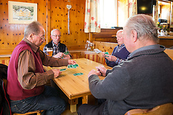 THEMENBILD - Das Kartenspiel Bauernschnapsen (auch Viererschnapsen) ist eine erweiterte Form des Schnapsens, bei dem 4 Spieler teilnehmen. Diese Form des herkömmlichen Schnapsens ist vor allem in Österreich weit verbreitet. Hier im Bild, v.l. Josef Bauernfeind, Josef Heidenberger, Peter Unterweger und Simon Bauernfeind bei einer Partie Bauernschnapsen. Aufgenommen im Gasthof Ködnitzhof am 8. April 2015 in Kals am Grossglockner // The card game Bauernschnapsen is an advanced form of Schnapsen at which 4 players participate. This form of conventional Schnapsens is particularly widespread in Austria. Recorded at Gasthof Ködnitzhof on April 8, 2015. Kals am Grossglockner, Austria. EXPA Pictures © 2015, PhotoCredit: EXPA/ Johann Groder