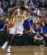 Feb. 28, 2012; Indianapolis, IN, USA; Indiana Pacers small forward Danny Granger (33) and Golden State Warriors power forward Ekpe Udoh (20) chase down a loose ball at Bankers Life Fieldhouse. Mandatory credit: Michael Hickey-US PRESSWIRE