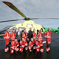 FREE TO USE PHOTOGRAPH....30.10.15<br /> Scotland's Charity Air Ambulance (SCAA) unveiled it's new helicopter at Perth airport this morning a EC135 T2i (pictured) which replaces the Bolkow 105 helicopter which is retiring from service. The new helicopter will increase speed, range, endurance and payload, allow SCAA to fly at night and in cloud. Pictured from left, Mark Tynan, Craig McDonald, David Craig SCAA Chief Exec, Maureen Young, Chief Pilot Russell Myles, Julia Barnes, John Salmond and Lead Paramedic John Pritchard.<br /> Front row from left, Paul Gowans, Phillip Campbell, Alan Finlayson and Chris Darlington<br /> for further info please contact Maureen Young on 07778 779000<br /> Picture by Graeme Hart.<br /> Copyright Perthshire Picture Agency<br /> Tel: 01738 623350  Mobile: 07990 594431