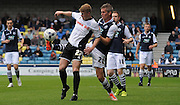 Steve Morrison and Andy Cannon battle for the ball during the Sky Bet League 1 match between Millwall and Rochdale at The Den, London, England on 26 September 2015. Photo by Michael Hulf.