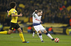 BRITAIN-LONDON-FOOTBALL-UEFA CHAMPIONS LEAGUE-TOTTENHAM VS DORTMUND.(190213) -- LONDON, Feb.13, 2019  Tottenham Hotspur's Christian Eriksen (R) shoots during the UEFA Champions League Round of 16 1st Leg match between Tottenham Hotspur and Borussia Dortmund at Wembley Stadium in London, Britain on Feb. 13, 2019. Tottenham Hotspur won 3-0.  FOR EDITORIAL USE ONLY. NOT FOR SALE FOR MARKETING OR ADVERTISING CAMPAIGNS. NO USE WITH UNAUTHORIZED AUDIO, VIDEO, DATA, FIXTURE LISTS, CLUB/LEAGUE LOGOS OR ''LIVE'' SERVICES. ONLINE IN-MATCH USE LIMITED TO 45 IMAGES, NO VIDEO EMULATION. NO USE IN BETTING, GAMES OR SINGLE CLUB/LEAGUE/PLAYER PUBLICATIONS. (Credit Image: © Xinhua via ZUMA Wire)