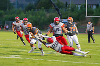 KELOWNA, CANADA - JULY 29: Eddy-Aurel Nyongwa #20 of Westshore Rebels attempts to tackle Robbie Rodrigues #25 of Okanagan Sun as he runs with the ball on July 29, 2017 at the Apple Bowl in Kelowna, British Columbia, Canada.  (Photo by Marissa Baecker/Shoot the Breeze)  *** Local Caption ***