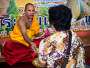 20 SEPTEMBER 2015 - SARIKA, NAKHON NAYOK, THAILAND:  A Hindu priest from India blesses people at the Ganesh festival at Shri Utthayan Ganesha Temple in Sarika, Nakhon Nayok. Ganesh Chaturthi, also known as Vinayaka Chaturthi, is a Hindu festival dedicated to Lord Ganesh. Ganesh is the patron of arts and sciences, the deity of intellect and wisdom -- identified by his elephant head. The holiday is celebrated for 10 days. Wat Utthaya Ganesh in Nakhon Nayok province, is a Buddhist temple that venerates Ganesh, who is popular with Thai Buddhists. The temple draws both Buddhists and Hindus and celebrates the Ganesh holiday a week ahead of most other places.    PHOTO BY JACK KURTZ