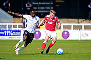 Wrexham Midfielder Ollie Shenton takes on Bromley Forward Tobi Sho-Silva during the Vanarama National League match between Bromley FC and Wrexham FC at Hayes Lane, Bromley, United Kingdom on 8 April 2017. Photo by Jon Bromley.