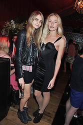 Left to right, CARA DELEVINGNE and CLARA PAGET at Tunnel of Love - a fashion & art party in aid of The British Heart Foundation held at The Proud Gallery, Camden, London on 29th May 2012.