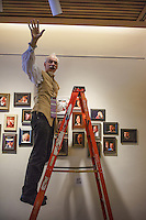 Russell Preston Brown adjust lights for the portrait wall