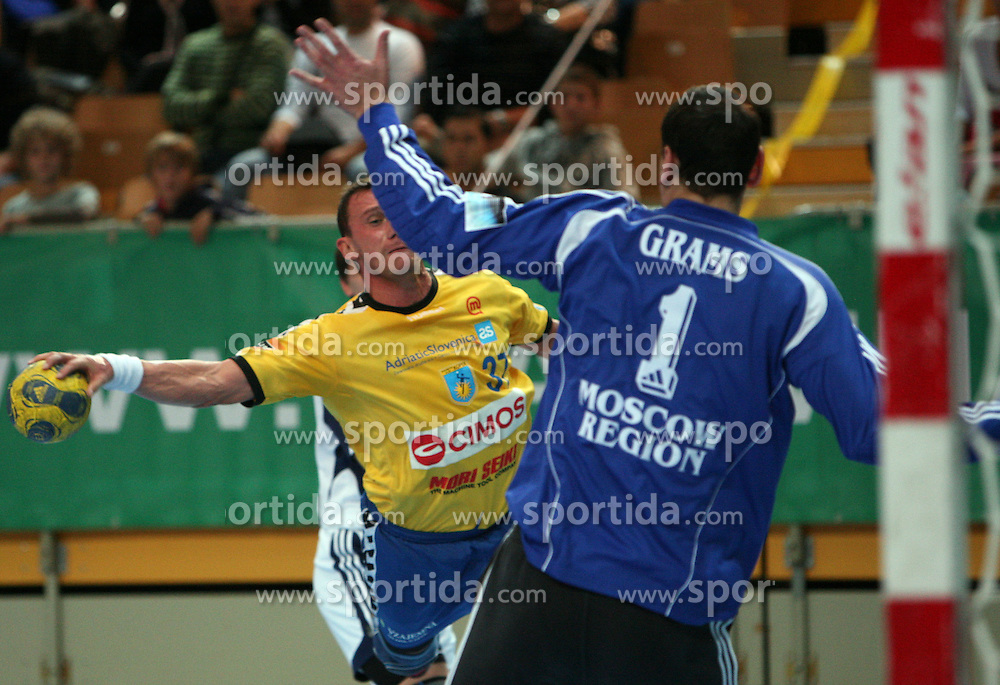 Zoran Jovicic of Koper vs goalkeeper Oleg Grams at handball match RK Cimos Koper vs Chehovskie Medvedi (RUS) in E group of EHF Champions league Men 2008/2009, on October 4, 2008 in Arena Bonifika, Koper, Slovenia. Chehovskie Medvedi won 35:28. (Photo by Vid Ponikvar / Sportal Images)