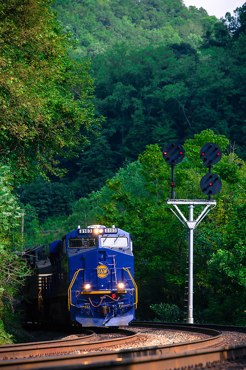 Norfolk Southern's Norfolk & Western 'Heritage Locomotive' passes a set of vintage N&W position lights in Welch, WV, bringing another set of empty coal hoppers back to the mines for loading.