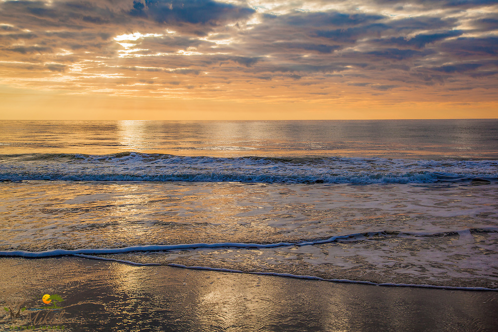 Grand Strand Morning sun over calm ocean