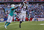 Leodis McKelvin hauls in an interception in the closing moments of a game against the Miami Dolphins in Buffalo, New York on September 14, 2014.