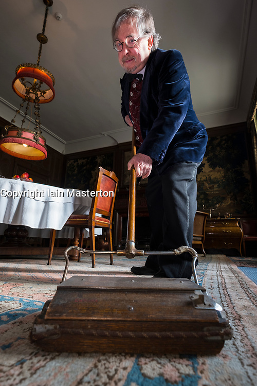Edinburgh, Scotland, United Kingdom . 27th February, 2018. Volunteers wearing Edwardian costumes prepare to give Lauriston Castle in Edinburgh a Spring clean in preparation for the public opening later in the year. Pictured Gordon Roberts with vintage carpet sweeper.