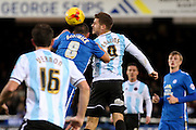 Peterborough United midfielder Michael Bostwick and Shrewsbury Town FC forwward James Collins challenge for the ball during the Sky Bet League 1 match between Peterborough United and Shrewsbury Town at the ABAX Stadium, Peterborough, England on 12 December 2015. Photo by Aaron Lupton.