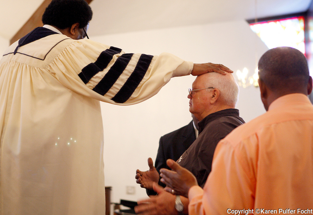 The Rev. Al Green blesses guest, Butts Giraud, who came all the way from Nanaimo, British Columbia, Canada for his blessing,  at his Full Gospel Tabernacle church on a recent Sunday morning. Legendary soul singer Al Green is about to receive a major national honor. Green is among the five artists who will receive this year's Kennedy Center honors. The national award is for influencing American culture through the arts. His church is located at 787 Hale Rd. in Memphis, TN.