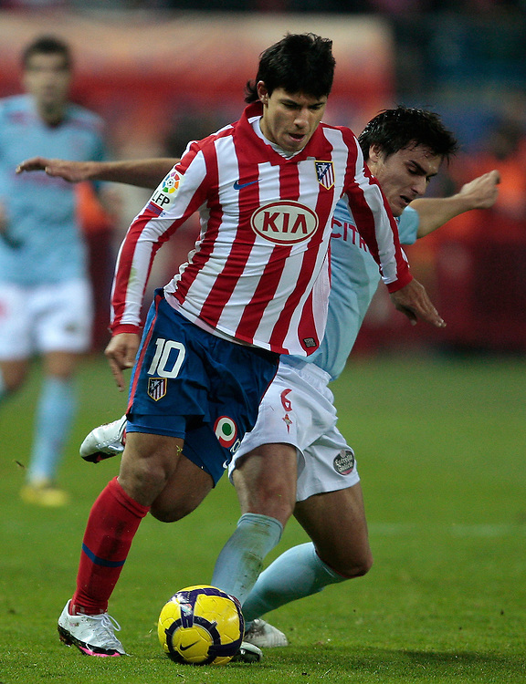 Atletico de Madrid's Sergio 'Kun' Aguero from Argentina, left, vies for the ball with Celta de Vigo's Jonathan Vila, right, during their Spanish Copa del Rey soccer match at the Vicente Calderon stadium in Madrid, Thursday, Jan. 21, 2010.