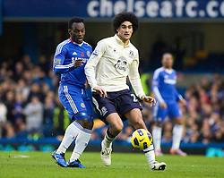 04.12.2010, Stamford Bridge, London, ENG, PL, FC Chelsea vs FC Everton, im Bild Everton's Marouane Fellaini holds off Chelsea's Michael Essien, Barclays Premiership, Chelsea v Everton, 04/12/2010. EXPA Pictures © 2010, PhotoCredit: EXPA/ IPS/ Mark Greenwood +++++ ATTENTION - OUT OF ENGLAND/UK and FRANCE/FR +++++