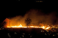 A building is affected by a forest fire near El Cubillo de Uceda, on August 11, 2012 in Guadalajara, Spain. During a heat wave dozens of forest fires have appeared in Spain, three of them at National Parks, like Teide, Doñana or Cabañeros, and thousands of people had to be evacuated at La Gomera and Tenerife, in the Canary Islands.